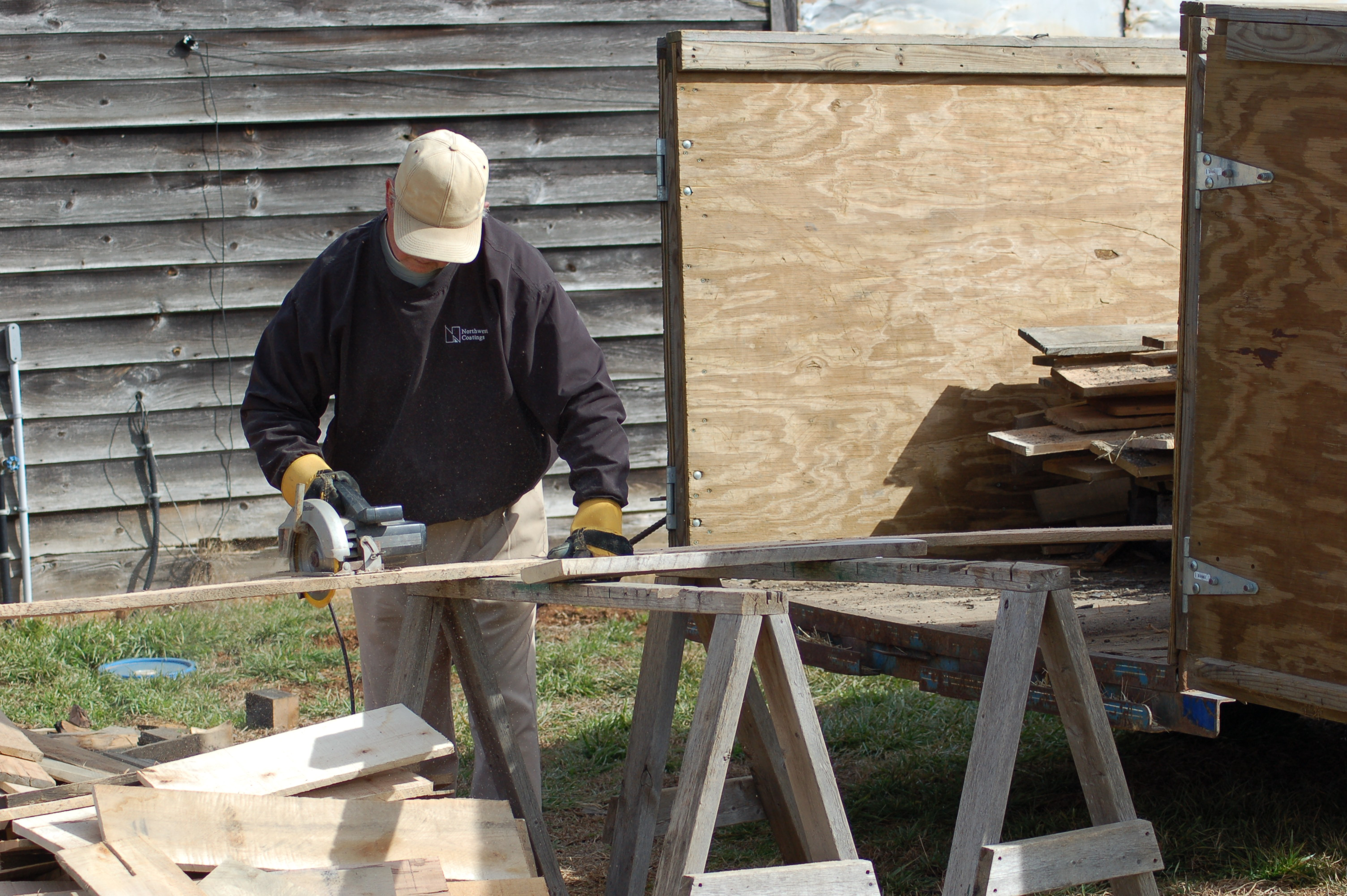 Sawing wood to heat the greenhouse
